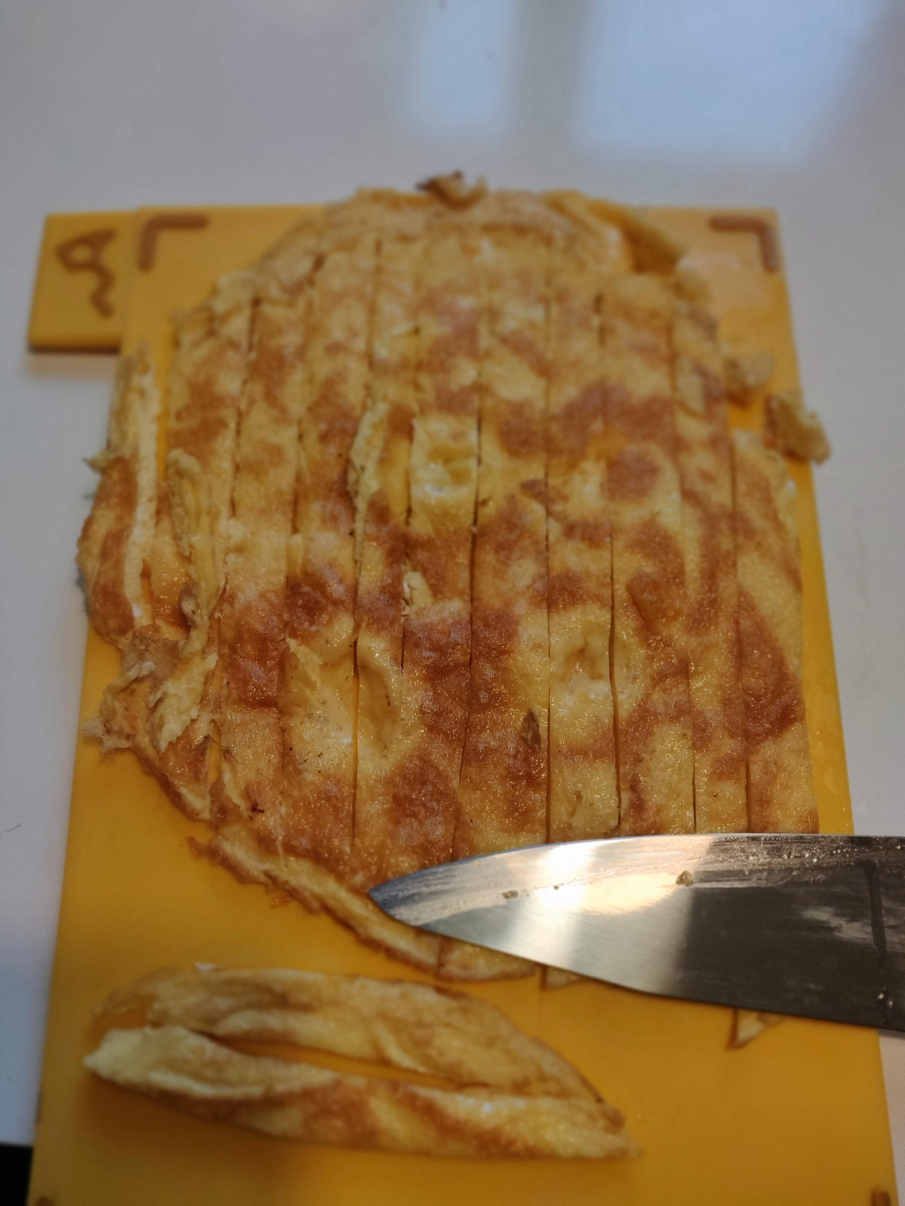 Thin slice the omelette