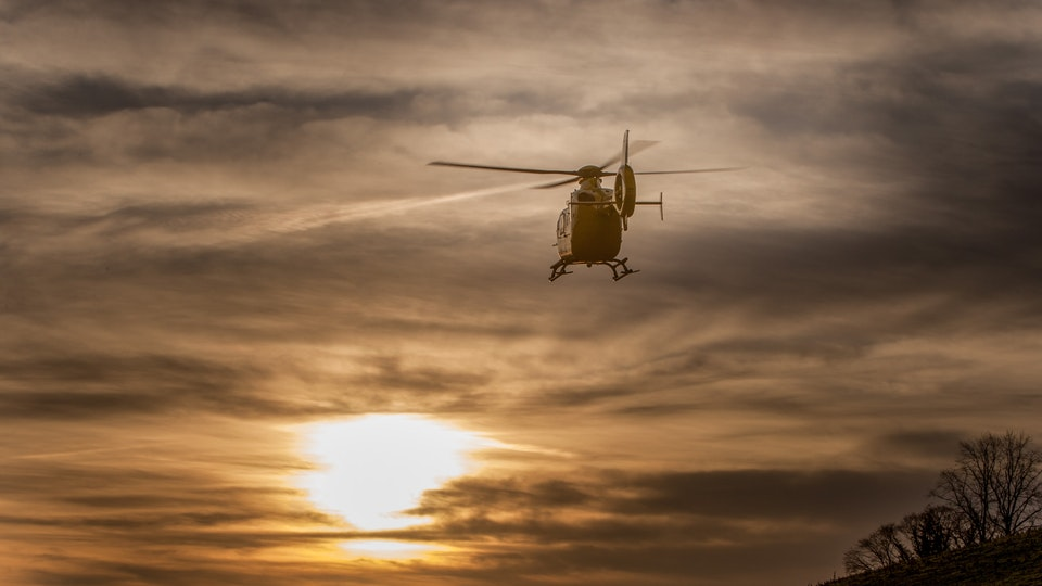General Commercial Photography - The North West Air Ambulance lifts out of Kendal as the sun rises.