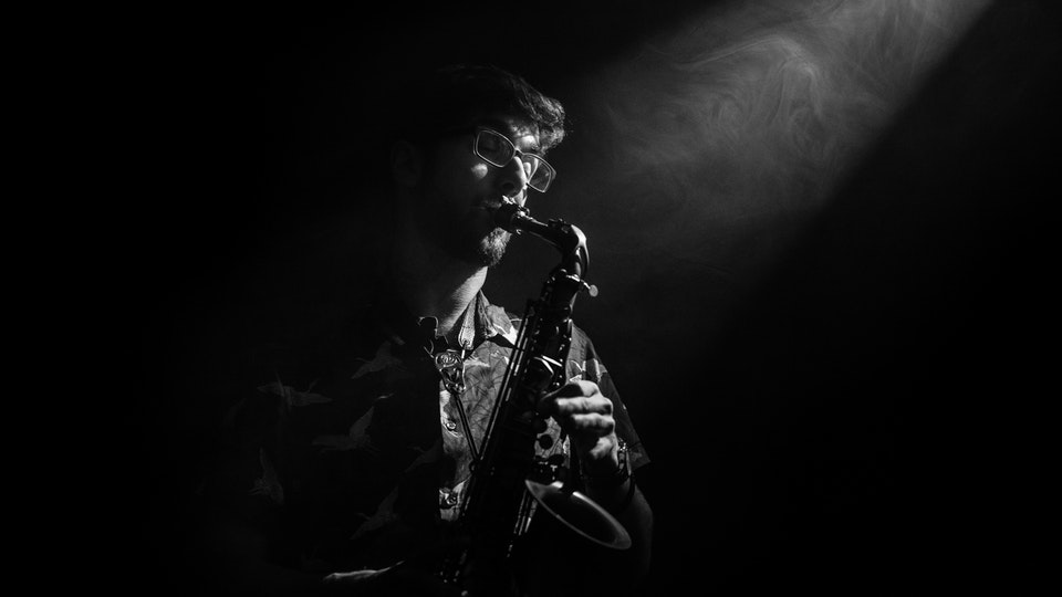 General Commercial Photography - Commission of Ollie playing his Sax for his parents new house, taken in the studio to give the mod of a late night club.