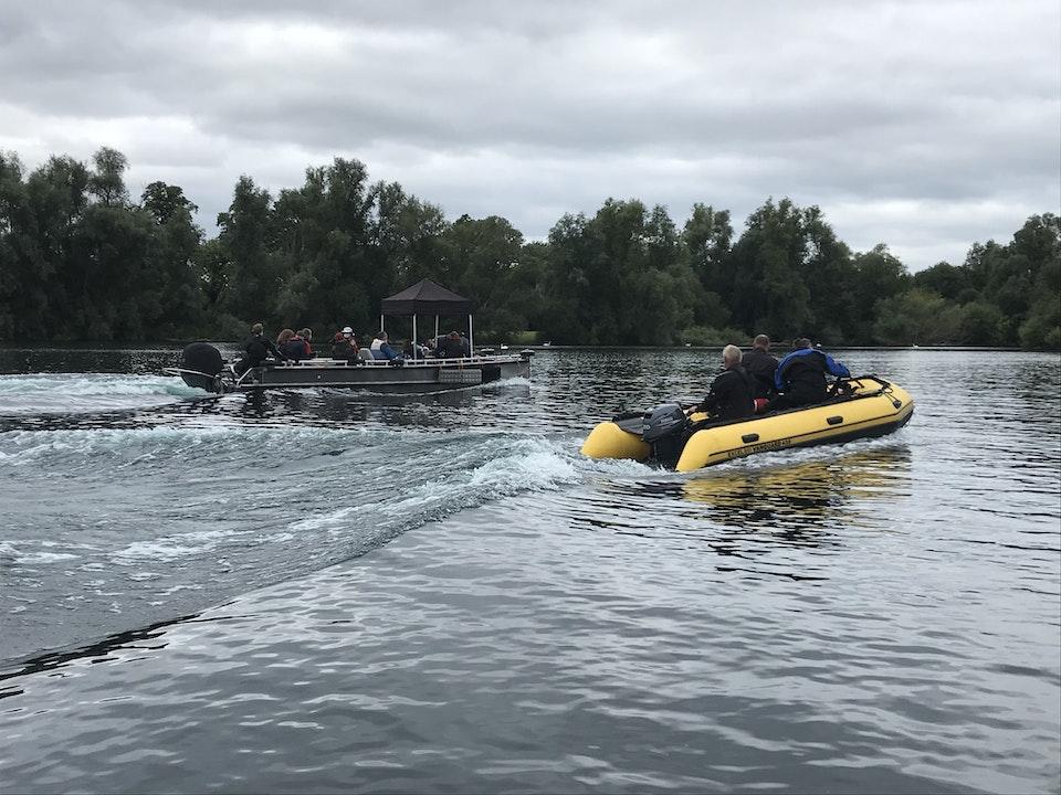 Safety Boat shadowing Large Camera Boat