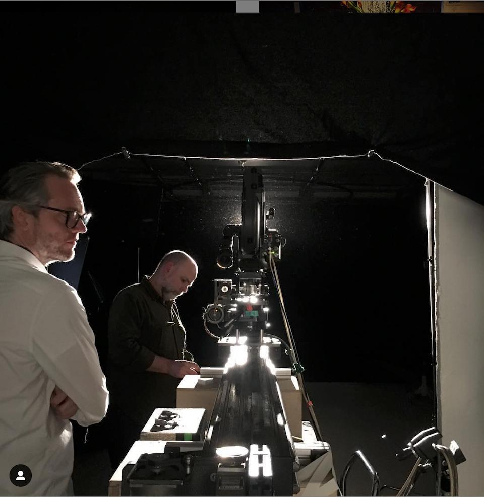 Cross Street Studio - Director James looks on...pensively. Dop Simon Paul plays games  on his phone