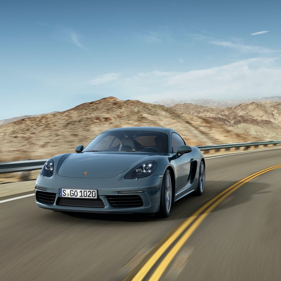 Porsche Cayman 718 - 09_78_Front_03_dynamisch
