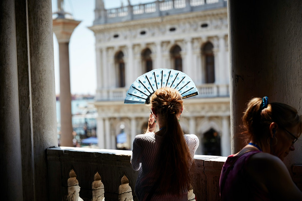 Lifestyle - Lady with a fan in Venice - Photographed for Topdeck Travel