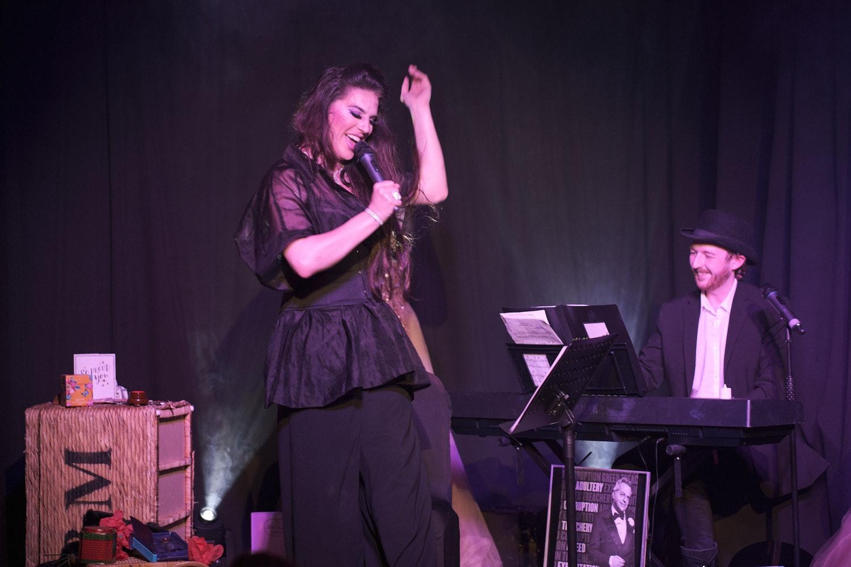 Topsie Redfern and musician Connor Fogel on stage at 'Topsie Redfern's Crystal Balls'