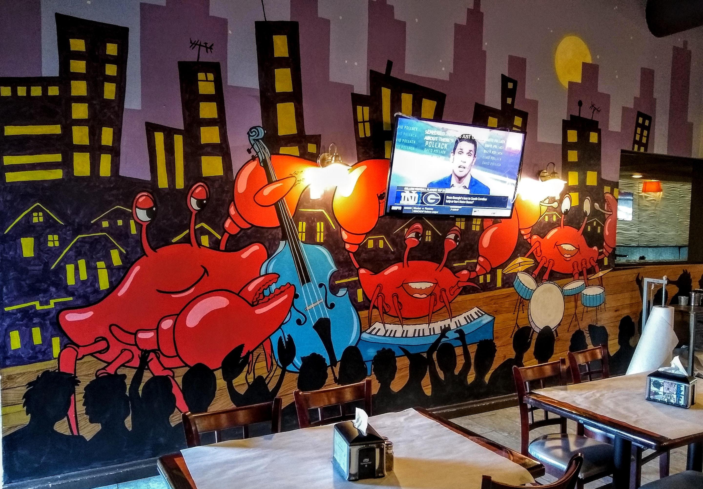 Working Artist Decorating - Crab City Restaurant