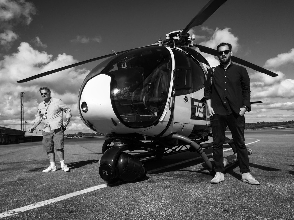 Oskar Wrangö with helicopter pilot Thomas Kristensen on set of Västtrafik's 'Drivers, You Are Our Future'
