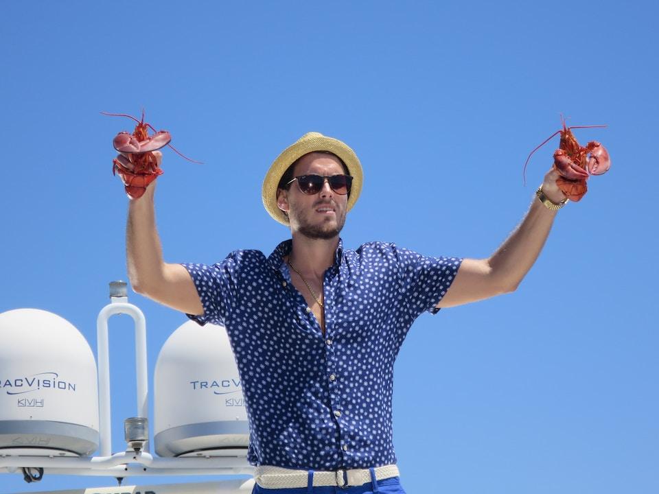 Robert Jitzmark directs man dancing with lobsters on set of Visa.