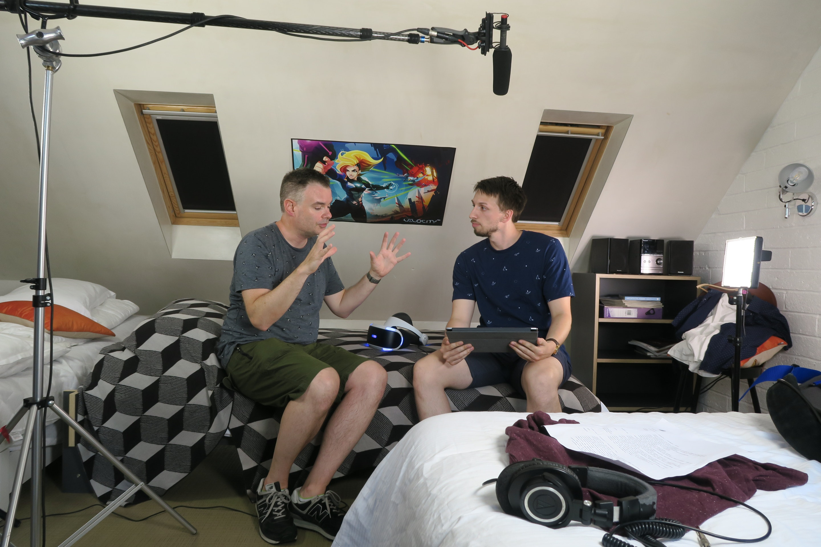 Game and UI artist Paul Simpson describbes the new Futurlab Sony Playstation VR game to actor Adam Leadbitter, behind the scenes on the Big Egg Futurlab trailer shoot