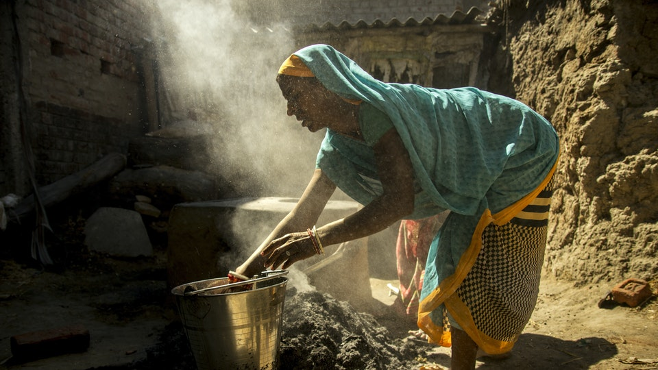 NEHA - Early morning. Women prepared cooking on a chulha, a traditional stove heated by firewood or dry cow dung cakes. It is commonly used for cooking and heating food in rural households.