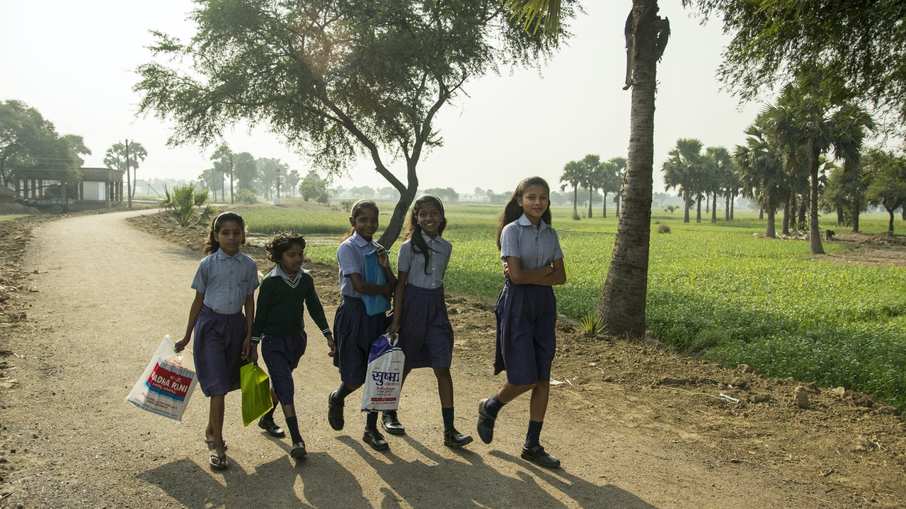 Education to Empowerment - Girls, sisters, friends, neighbors from nearby villages on the way to school. Seeing those happy faces walking together through green fields is one of the best scenes in the morning.<br>Bihar is one of India's most illiterate states and has the lowest female literacy rate. Most girls were married off before 18 and believed to have no economic benefit for their parents.<br>Many girls in rural villages have never attended school. Bodhi Tree Foundation works hard in creating equal access to education between boys and girls.
