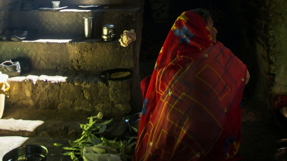 NEHA - Early morning. Women prepared cooking on a chulha, a traditional stove heated by firewood or dry cow dung cakes.<br> It is commonly used for cooking and heating food in rural households.