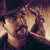Podcasts - Portrait of Lin-Manuel Miranda as Lee Scoresby (with his accompanying Daemon) from the HBO/BBC adaptation of His Dark Materials.