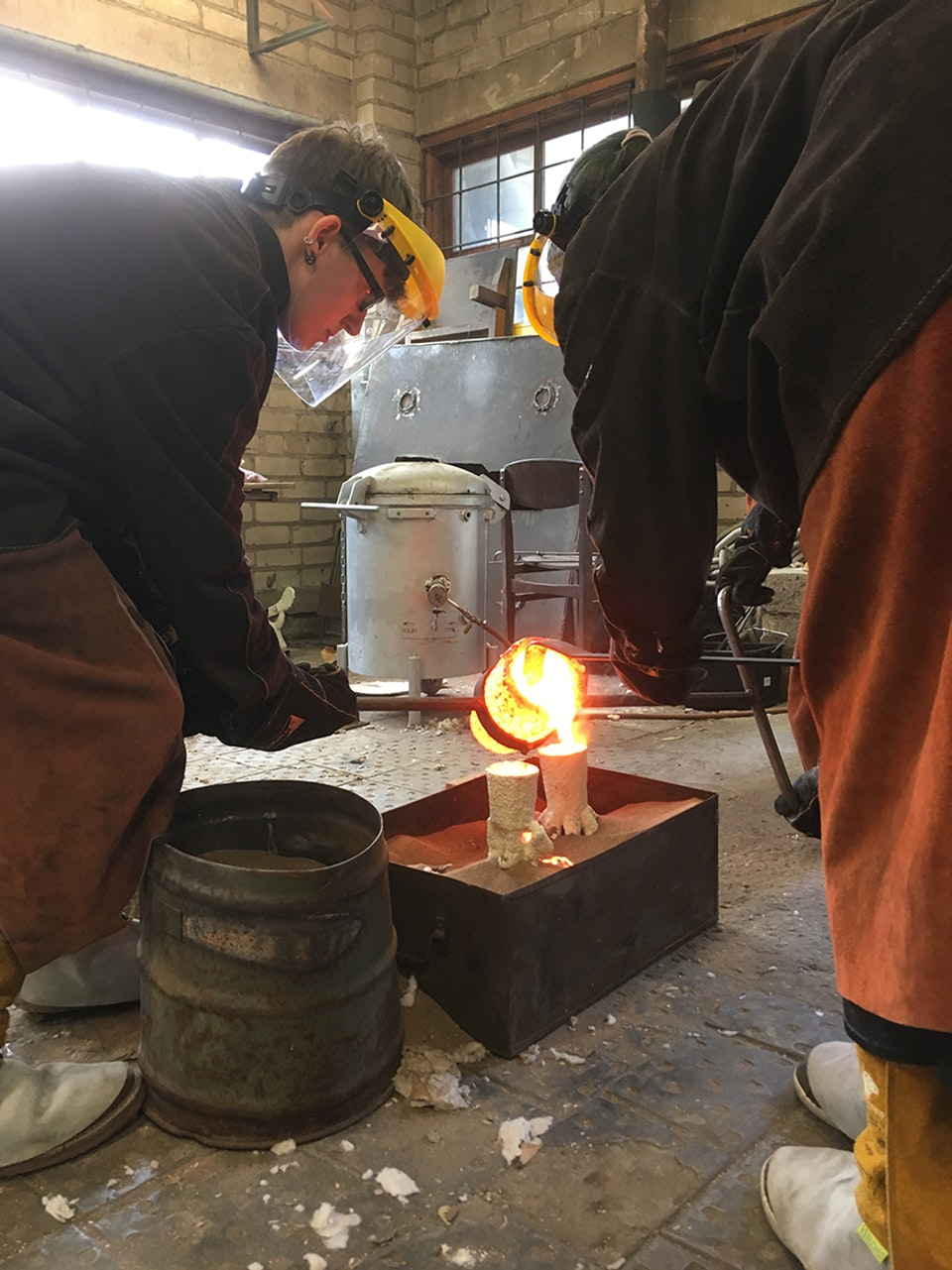Alchemical Bronze Casting - Students pouring, drossing