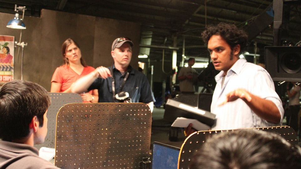 "Worker Drone - Sharat working on the set of ""Worker Drone"" with cinematographer Matthew Blute and First AD Rachel Jensen. (Photo Credit: Lynn Gettman)"