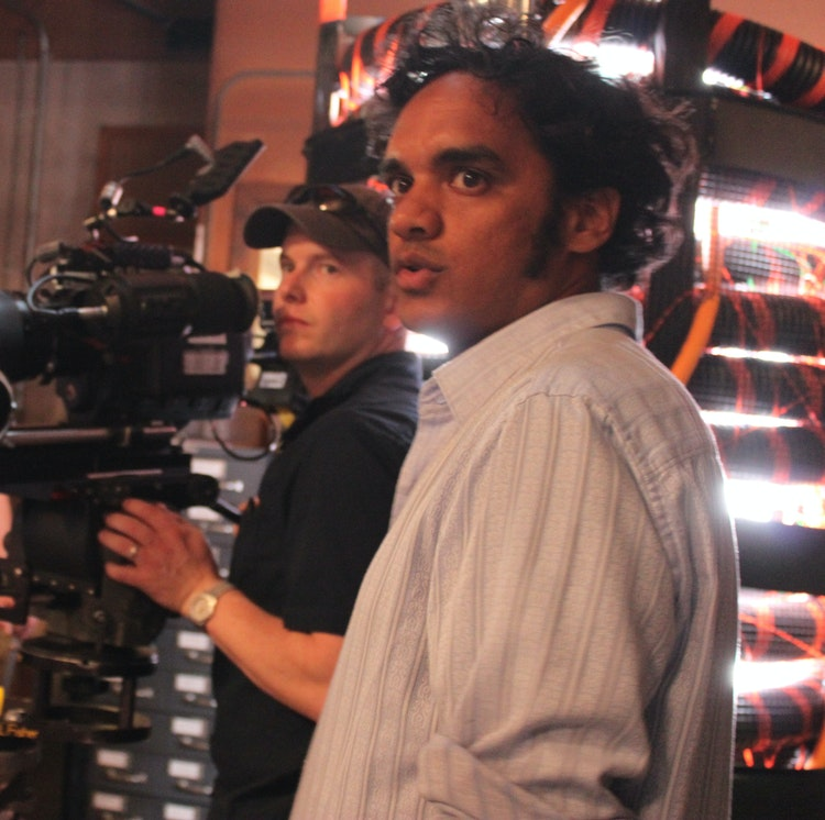 """Worker Drone - Sharat working with cinematographer Matthew Blute on the set of """"Worker Drone."""" (Photo Credit: Lynn Gettman)"""