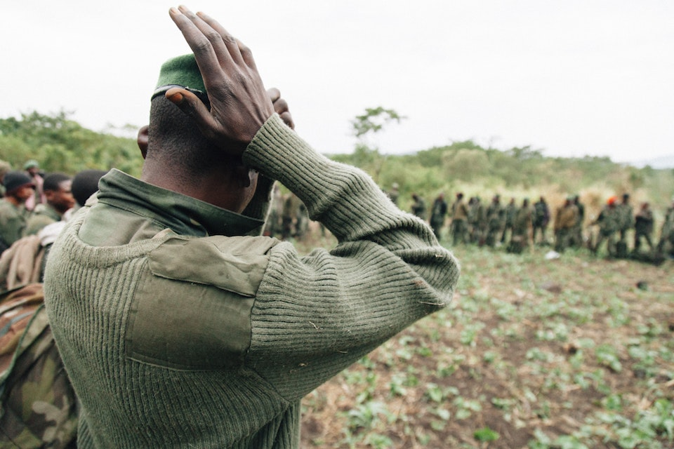 North Kivu | Democratic Republic of Congo - A FARDC soldiers arranges his hat. His platoon is about to enter Virunga searching for FDLR rebels.
