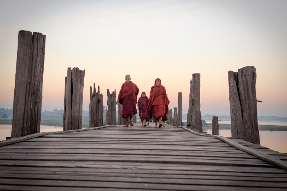 Monks commuting on U Bein Bridge, Myanmar