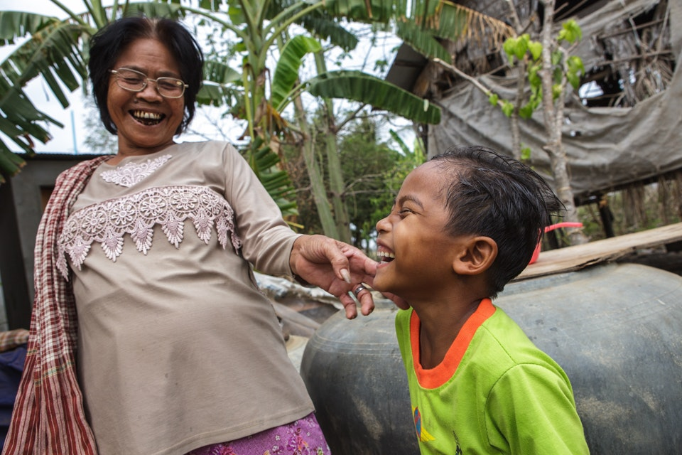 Chetra and his grandmother, Handicap International