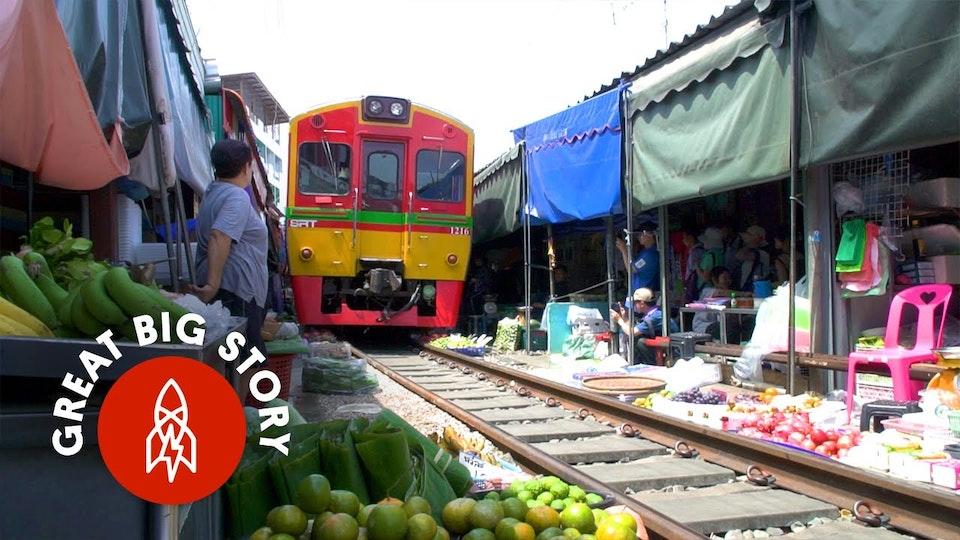 Watch a Train Run Through Thailand's Most Dangerous Market