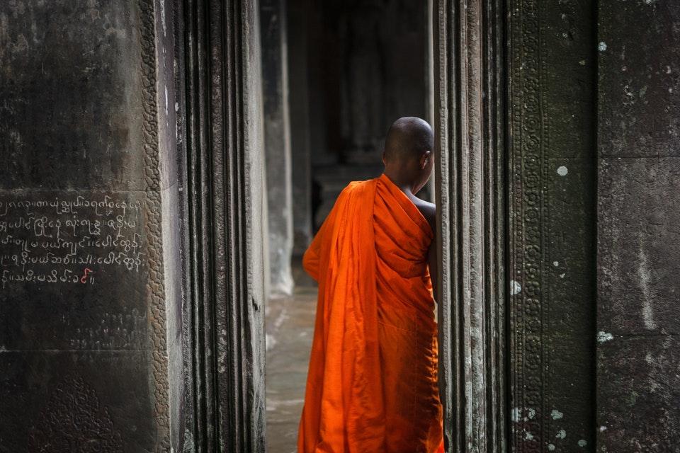 Buddhist Monk among stone temples, Angkor Wat