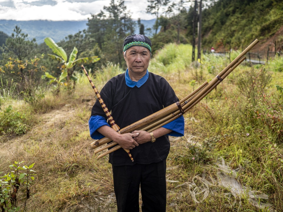 Hmong man guides the spirits to their final resting place