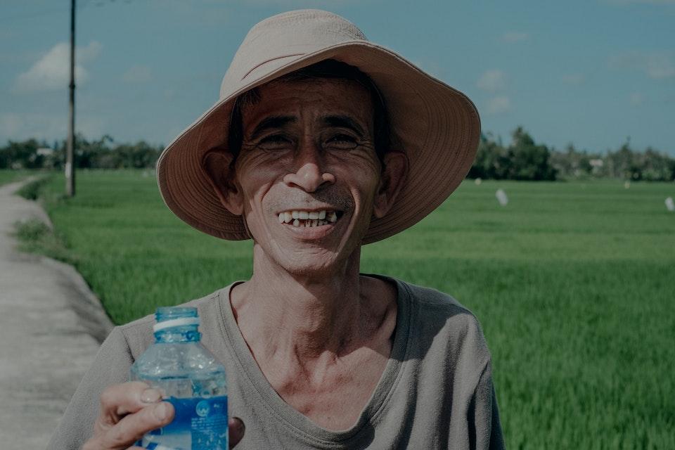Vietnam by Dirtbike (2013) farmer