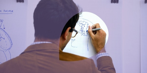 ENGAGE Male researcher drawing 600x300