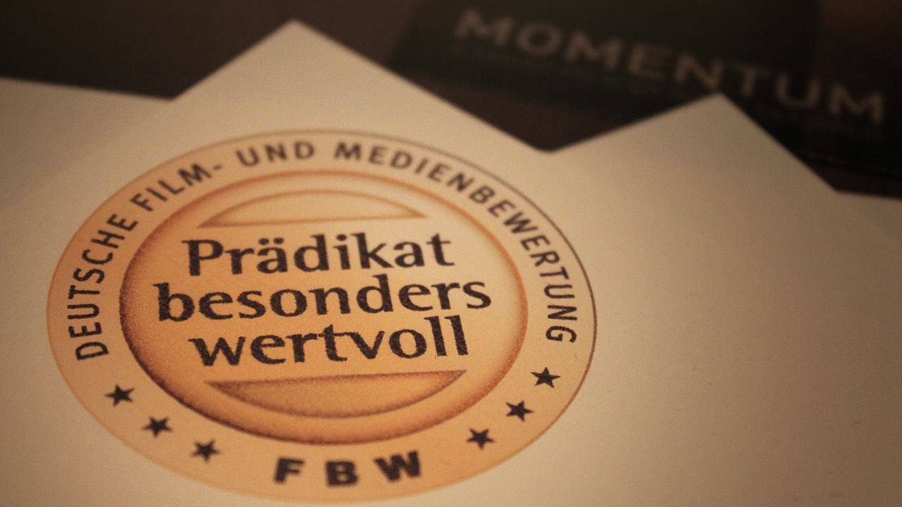 "Momentum - Momentum receiving the certification mark ""Especially Valuable"" from the German Film and Media Evaluation Institute"