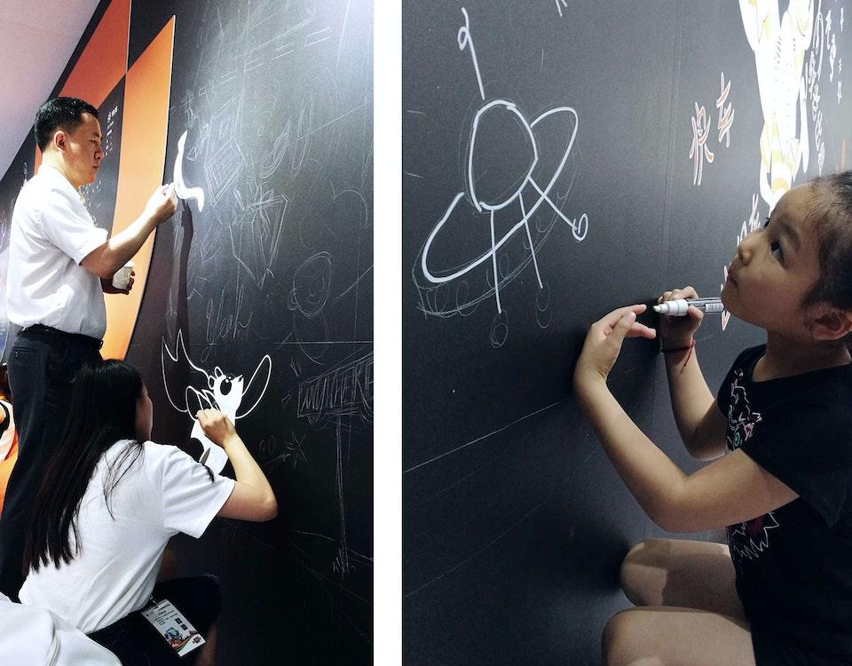 6-Didi-mural-day-2-painting-people-help -