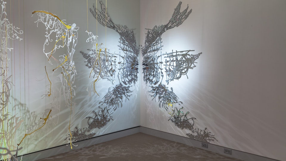 Lily Ponder - LILY PONDER size variable   watercolor on hand cut paper, mylar, 2-way mirror, fluorescent lighting, thread   2012    UMaine Art Museum, Bangor, ME
