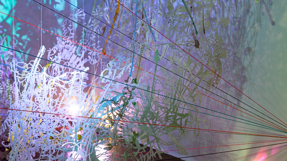 Of Night and Light and Half Light - OF NIGHT AND LIGHT AND THE HALF LIGHT   120 x 216 x 120   watercolor, metallic powder, glitter on hand-cut paper, string, yarn, projected video, lighting   2015 Craft Contemporary   Los Angeles © Chris Natrop