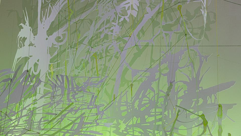 Glitterati Swamp Thing - GLITTERATI SWAMP THING | site-specific commission | 14 x 10 x 3 feet | watercolor, iridescent medium on cut paper, fluorescent fixtures, color gel overlays  © CHRIS NATROP