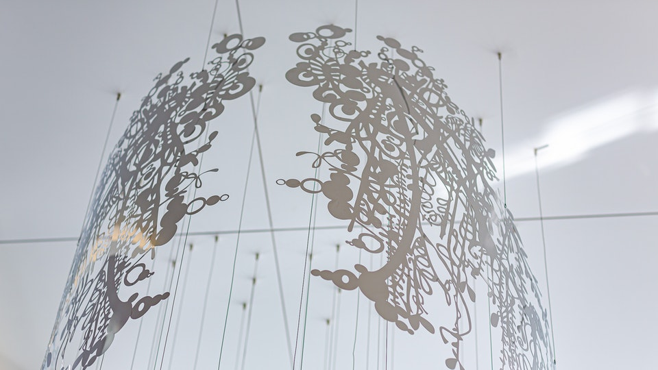 Life Above the Fray - LIFE ABOVE THE FRAY – permanent mirror metal aerial sculpture atop the AON BUILDING, DTLA – chemical etched and precision bent – 55 x 55 x 180 inches